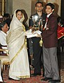 The President, Smt. Pratibha Patil presenting the Arjuna Award -2006 to Shri Saurav Ghosal for Squash at a glittering function, in New Delhi on August 29, 2007.jpg