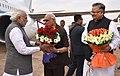 The Prime Minister, Shri Narendra Modi being received by the Governor of Chhattisgarh, Shri Balramji Das Tandon and the Chief Minister of Chhattisgarh, Dr. Raman Singh, on his arrival at Raipur, Chhattisgarh.jpg