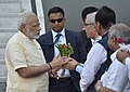 The Prime Minister, Shri Narendra Modi being received by the Governor of Gujarat, Shri O.P. Kohli and the Chief Minister of Gujarat, Shri Vijay Rupani, on his arrival, at Ahmedabad, Gujarat on September 13, 2017.jpg