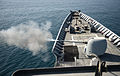 The forward Mark 45 5-inch gun aboard the guided missile cruiser USS Gettysburg (CG 64) fires during a live-fire exercise in the Gulf of Oman Nov. 1, 2013 131101-N-MY642-056.jpg