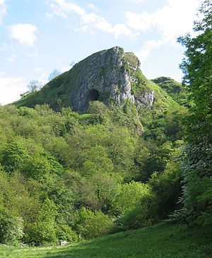 Pennines - Limestone scenery: Thor's Cave, Staffordshire, from the Manifold Way. Limestone is common in the White Peak and Yorkshire Dales, making those areas distinct from other parts of the Pennines.