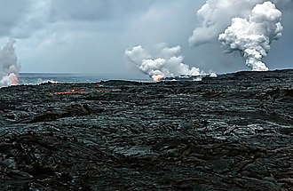 Hawaii (island) - Steam plume as Kīlauea red lava enters the ocean at three Waikupanaha and one Ki lava ocean entries. Some surface lava is seen too. The image was taken on 16 April 2008.