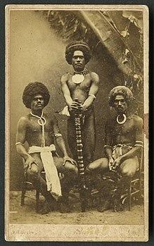 Three Kai Colo Men In Traditional Fijian Attire