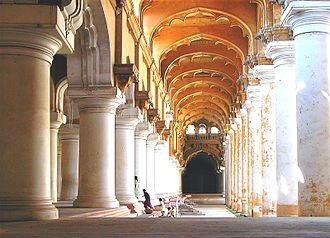 Thirumalai Nayakkar Mahal - sun lit view of the corridor around the courtyard of the palace