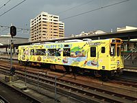 Train MR-609 of Matsuura Railway stopping at Sasebo Station 20141231.JPG