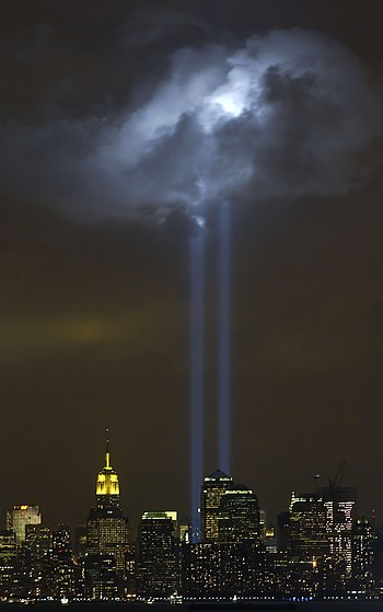 """New York City, N.Y. (Sept. 9, 2004) - As the anniversary of the September 11, 2001 terroist attack approaches, a test of the Tribute in Light Memorial illuminates a passing cloud above lower Manhattan. The twin towers of light, made-up of 44 searchlights near """"Ground Zero,"""" are meant to represent the fallen twin towers of the World Trade Center. Depending on weather conditions, the columns of light can be seen for at least 20 miles around the trade center complex. U.S. Coast Guard photo by Public Affairs 2nd Class Mike Hvozda"""