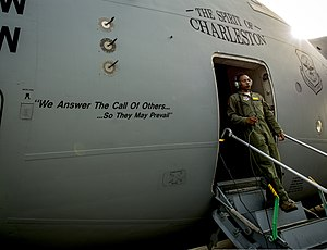 U.S. Air Force Airman 1st Class Trae Williams, a loadmaster with the 16th Airlift Squadron, exits a C-17 Globemaster III aircraft July 30, 2013, at Joint Base Charleston, S.C 130730-F-LR006-071.jpg