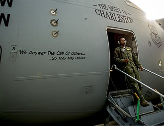 16th Airlift Squadron - A 16th Airlift Squadron loadmaster exits a C-17 Globemaster III aircraft at Joint Base Charleston