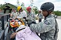 U.S. Airmen and Soldiers with the Florida Army National Guard and the Florida Air National Guard treat simulated casualties during Vigilant Guard at Camp Blanding Joint Training Center, Fla., May 19, 2013 130519-Z-XH297-005.jpg