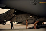 U.S. Marines assigned to the 266th Medium Tilt Rotor Squadron and U.S. Airmen from the 10th and 6th Airlift Squadrons spot a U.S. Marine Corps MH-53E Super Stallion helicopter as it is unloaded from a C-17A 100826-F-RR679-166.jpg