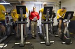 U.S. Navy Chief Aviation Ordnanceman Dennis Guernsey, center, monitors participants in the alternate cardio portion of a physical readiness test in the hangar bay of the aircraft carrier USS Harry S. Truman (CVN 131005-N-ZG705-164.jpg