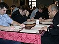 US Navy 040304-N-8861F-001 U.S. Navy Sailors take the E-6 rating advancement exam at the Capodichino Ciao Hall early in the morning.jpg