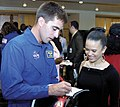 US Navy 040506-N-0057D-006 Lt. Cmdr. Chris Cassidy, right, signs an autograph for Ms. Bianca Baker from Portsmouth, Va.jpg