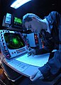 US Navy 041026-N-5362F-016 Operations Specialist 3rd class Jon Morgantini of Santa Barbra, Calif., uses the SPA-25 surface radar aboard USS Abraham Lincoln (CVN 72) to plot surface contacts.jpg