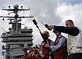 US Navy 041129-N-9079D-019 Torpedoman's Mate John N. Hansen receives instruction on where to aim a shot line from the Nimitz-class aircraft carrier USS Abraham Lincoln (CVN 72).jpg