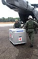 US Navy 050108-N-3970R-019 Cpl. Ian Ballentyne offloads medical supplies from a CH-53E Super Stallion helicopter at Muebaloh City Air Field.jpg