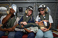US Navy 050206-N-6665R-100 Cmdr. Karen McDonald, center, and a nurse from the non-governmental organization Project Hope, comfort a young boy suffering from a perforated appendix.jpg