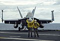 US Navy 050622-N-8604L-065 Aircraft directors signal for an F-A-18F Super Hornet to taxi.jpg