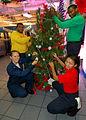 US Navy 061206-N-0490C-003 Crew members assigned to USS Dwight D. Eisenhower (CVN 69) decorate a Christmas tree.jpg