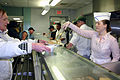 US Navy 070202-N-8110K-047 Information Systems Technician 1st Class Tanya Whitner and fellow Sailors assigned to guided missile cruiser USS Mahan (DDG 72) serve lunch to homeless veterans at the New England Shelter for Homeless.jpg
