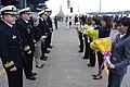US Navy 071026-N-7883G-039 Commanding officer of USS Kitty Hawk (CV 63), receive flowers during a welcome ceremony for USS Fitzgerald and USS Kitty Hawk.jpg