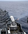 US Navy 071107-N-4774B-007 The Phalanx close-in weapon system fires nearly 75 rounds per second during a training exercise aboard amphibious assault ship USS Tarawa (LHA 1).jpg