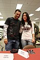 US Navy 080103-M-5276L-012 Sunny Garcia, left, a fighter and Arianny Celeste, a ring girl of the Ultimate Fighting Championship, stand side by side during the Affliction autograph signing at the Marine Corps Air Station Miramar.jpg