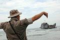 US Navy 080918-N-8132M-284 Boatswain's Mate Seaman Gregory Newland directs a utility landing craft from t he amphibious assault ship USS Nassau (LHA 4) onto the beach near the port of Galveston.jpg