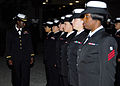 US Navy 081024-N-2565P-010 Ensign Ebony Miller inspects female Sailors during an early morning All Hands dress blues inspection.jpg