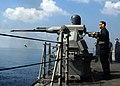 US Navy 081107-N-5416W-005 Gunner's Mate 2nd Class Michael Finch test fires a 25mm gun aboard the guided-missile cruiser USS Monterey (CG 61).jpg