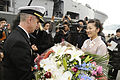 US Navy 090205-N-7280V-015 Capt. Thom W. Burke, commanding officer of the amphibious command ship USS Blue Ridge (LCC 19) is presented flowers on behalf of the Seihi-Kai Home for Senior Citizens after mooring pier side in Nagas.jpg