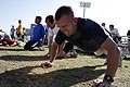 US Navy 090314-N-5366K-056 Athletes battle through two minutes of push ups during the Navy SEAL Fitness Challenge at Arizona State University in Phoenix.jpg