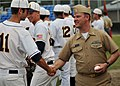 US Navy 090615-N-1229B-024 Aviation Electrician's Mate Senior Chief Gregory Sterling from Leesville, La. shakes hands with players from the Kitsap Bluejackets during military appreciation night for the Bluejackets.jpg