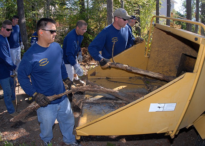 File:US Navy 090912-N-9860Y-005 chief petty officer selects feed logs and brush into a wood chipper.jpg