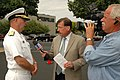 US Navy 090916-N-7975R-021 Rear Adm. Scott Weikert, deputy commander of First Naval Construction Division, speaks with WGAL TV field reporter Ed Weinstock during an interview at the Caterpillar plant in York, Pa.jpg