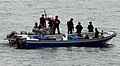 US Navy 100331-N-7058E-704 A response team of Sailors and Coast Guardsmen from the littoral combat ship USS Freedom (LCS 1) question four suspected drug smugglers after their.jpg