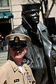 US Navy 100401-N-9818V-009 Master Chief Petty Officer of the Navy (MCPON) Rick West stands by the Lone Sailor statue.jpg