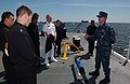 US Navy 100428-N-0000G-002 Aerographer's Mate 2nd Class William Donovan shows Naval Academy midshipmen and faculty the various tools used in oceanographic missions.jpg