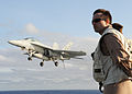 US Navy 100513-N-3620B-085 Lt. Elliott Shoup watches as an F-A-18F Super Hornet assigned to VFA-11 performs an arrested landing aboard the USS Enterprise (CVN 65).jpg