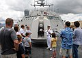 US Navy 100626-N-7058E-004 Lt. Cmdr. Earl Timmons assigned to the littoral combat ship USS Freedom (LCS 1) explains the specifics of Freedom's Mk-110 57mm gun to visitors during a public tour.jpg