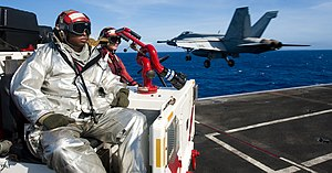 US Navy 120206-N-OY799-423 A Sailor observe as a jet launches off the flight deck.jpg