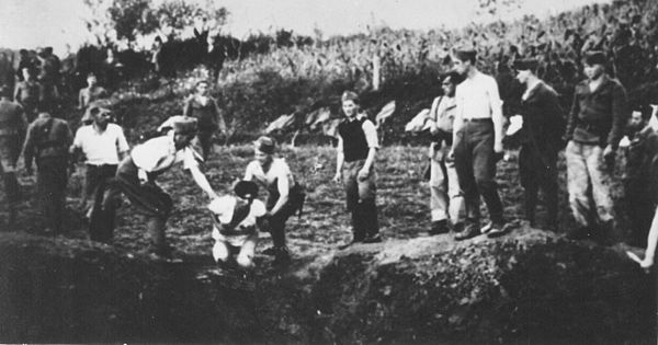 Ustase executing people over a mass grave in the vicinity of the Jasenovac concentration camp Ustase militia execute prisoners near the Jasenovac concentration camp.jpg