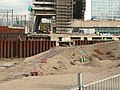 View over large excavations for new constructions on Oosterdokseiland in Amsterdam-Centrum.jpg