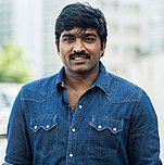 Vijay Sethupathi looking at the camera