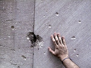 Wall Street bombing - Remnants of the damage from the 1920 bombing are still visible on 23 Wall Street.