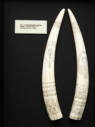 Scrimshaw - Pair of walrus tusks depicting a sailor and a woman. Rhode Island or Connecticut, circa 1900