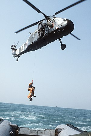 British Forces Overseas Hong Kong - The survivors of a simulated aircraft crash are hoisted aboard a Royal Air Force Westland Wessex HC Mk 2 helicopter from No. 28 (AC) Squadron in 1983.