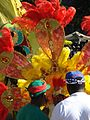 West Indian Day Parade, two men, and woman in costume.jpg