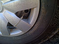 Wheelcover with cable tie - detail.jpg
