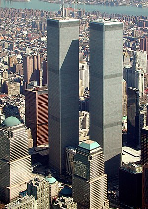 World Trade Center (1973–2001) - The original World Trade Center in March 2001. The tower on the left, with antenna spire, was 1 WTC. The tower on the right was 2 WTC. All seven buildings of the WTC complex are partially visible; refer to map below. The red granite-clad building left of the Twin Towers was the original 7 World Trade Center. In the background is the East River.